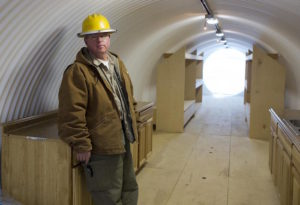 "Paul Seyfried stands in a bunker he is constructing for a client at Utah Shelter Systems in North Salt Lake, Utah, December 12, 2012. The price of the shelters range from $51,800 to $64,900. While most ""preppers"" discount the Mayan calendar prophecy, many are preparing to be self-sufficient for threats like nuclear war, natural disaster, famine and economic collapse. Picture taken December 12, 2012. REUTERS/Jim Urquhart (UNITED STATES - Tags: SOCIETY BUSINESS CONSTRUCTION)"