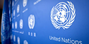 U.N. logo pattern a press conference background at the United Nations headquarters, Tuesday, Sept. 3, 2013. (AP Photo/Bebeto Matthews)